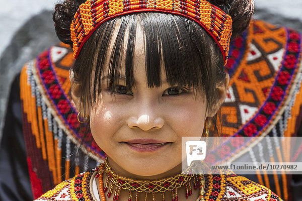 Girl in traditional Torajan dress attending a funeral ceremony at a rante  the ceremonial site for a Torajan funeral  in Sereale  Toraja Land  South Sulawesi  Indonesia