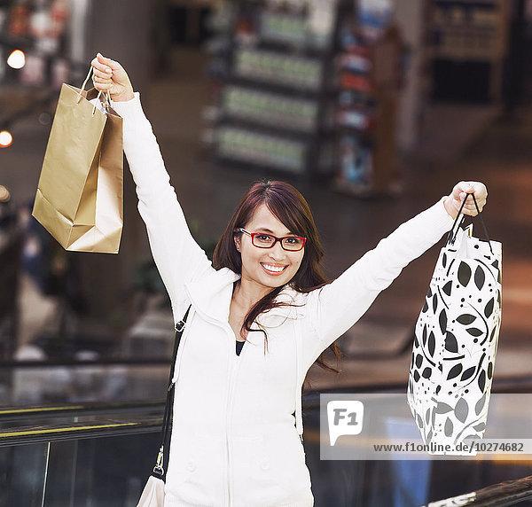 'Woman shopping at a mall; St. Albert  Alberta  Canada'