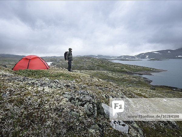 Hiker camping in mountains