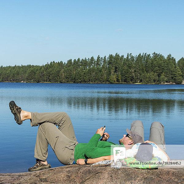 Mann Entspannung See