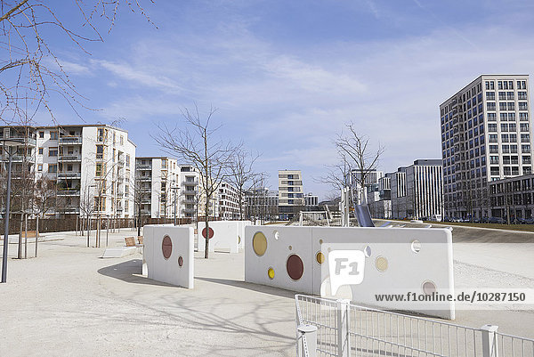 Playground surrounded by modern buildings in city  Munich  Bavaria  Germany