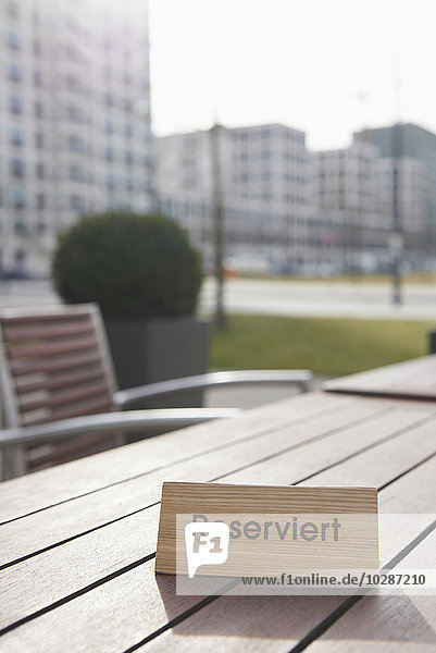 Reserved sign on the table in a sidewalk cafe  Munich  Bavaria  Germany