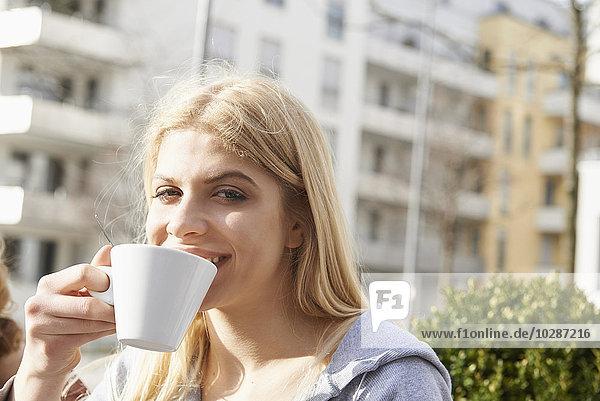 Portrait of a teenage girl drinking coffee  Munich  Bavaria  Germany