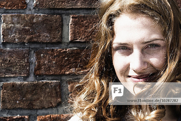 Close-up of Caucasian young woman smiling  Munich  Bavaria  Germany