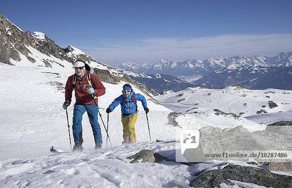 Ski mountaineers climbing on snowy mountain  Zell am See  Austria