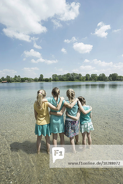 Group of friends standing in lake  Bavaria  Germany