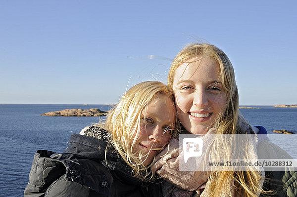 Sweden  Bohuslan  Lysekil  Portrait of friends on beach