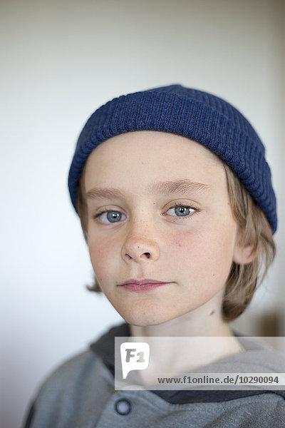 Sweden  Vastergotland  Lerum  Portrait of boy (10-11) wearing blue knit hat