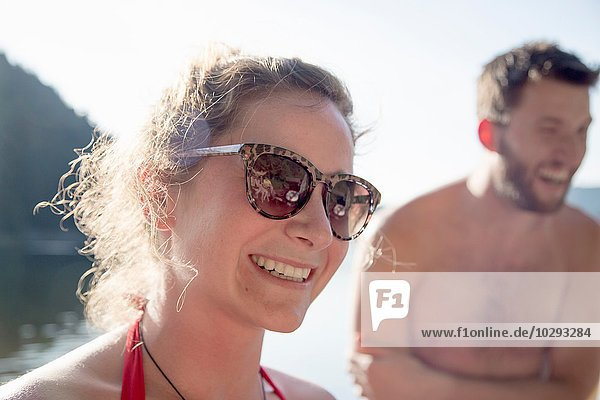 Young woman wearing sunglasses  smiling