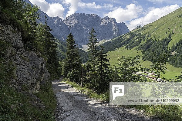 Trail  Laliderer Walls mountains behind  Almdorf Eng at the bottom right side  Eng Alm  Karwendel  Tyrol  Austria  Europe