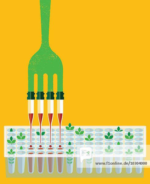 Gabel mit Pipetten-Zacken tropft Chemikalien in Reagenzglas-Tablett