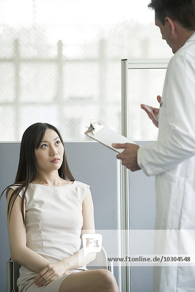 Doctor speaking with patient in waiting room