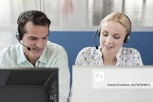 Telemarketer  die im Call Center arbeiten