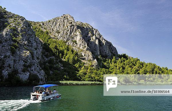 Croatia  Krka National Park  tourboat and landscape with rock
