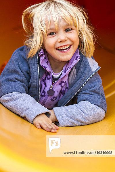 Portrait of happy little girl on a shute