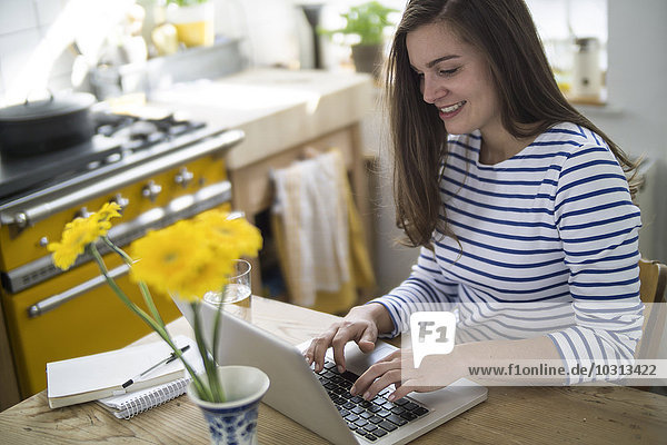 Young woman using laptop  working from home