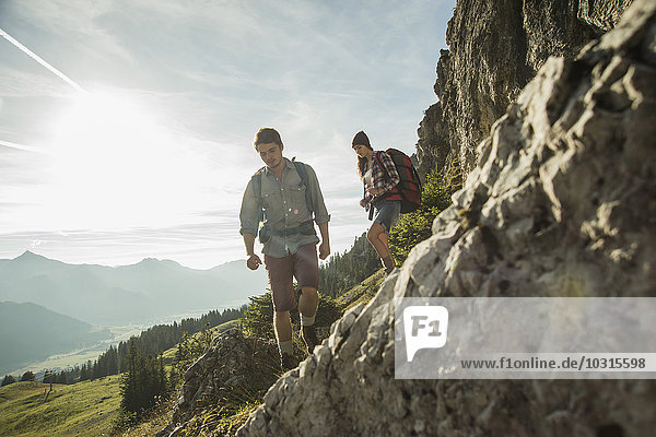 Austria  Tyrol  Tannheimer Tal  young couple hiking at rocks