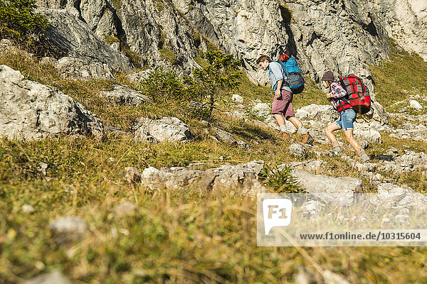 Austria  Tyrol  Tannheimer Tal  young couple hiking