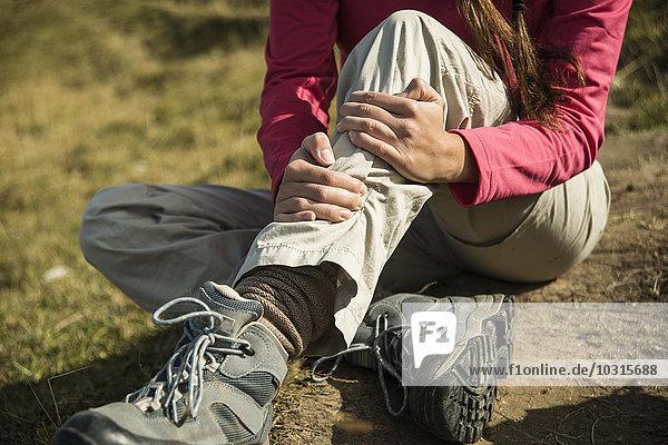 Austria  Tyrol  Tannheimer Tal  injured young woman on hiking tour