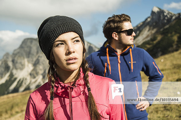 Austria  Tyrol  Tannheimer Tal  young couple in mountains