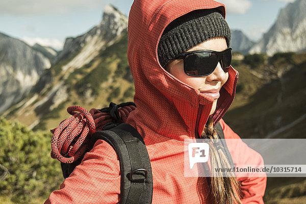 Austria  Tyrol  Tannheimer Tal  female hiker wearing sunglasses