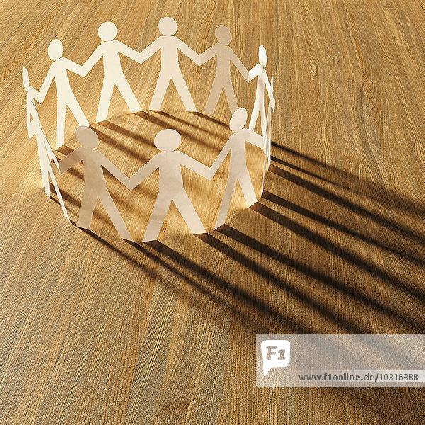 Kreis aus weißem Karton Männer auf Holz  3D Rendering