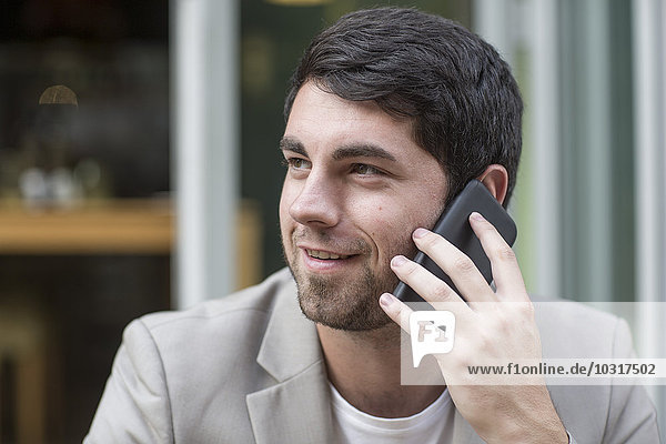 Smiling man on cell phone