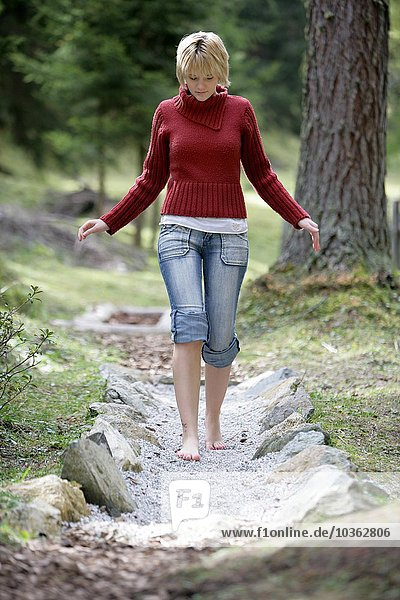 Hiking path in the mountains to the Schlickeralm. A barefoot walking path. Were hiker can walk on different  naturel materials