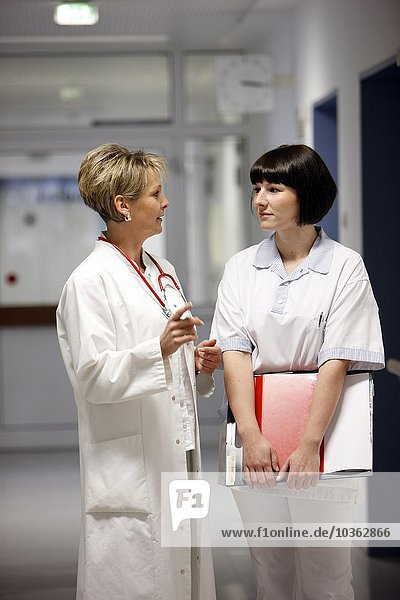 Female Doctor in a hospital. Talking to a nurse