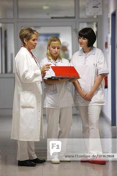 Female Doctor in a hospital. Talking to nurses