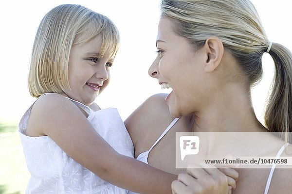 MODEL RELEASED. Mother and daughter cuddling. Mother and daughter