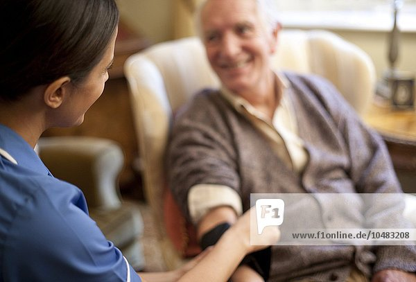 PROPERTY RELEASED. MODEL RELEASED. Measuring blood pressure. Measuring blood pressure