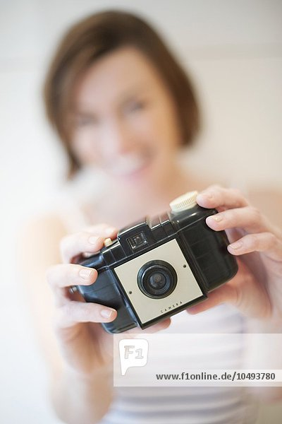 MODEL RELEASED. Woman taking photograph. Woman taking photograph