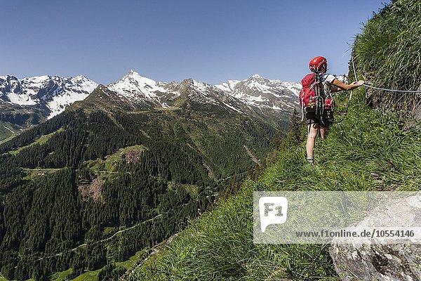 Mountaineer climbing to the Lampskopf  Via Ferrata in Pflersch at the foot of Tribulaun  Weather Spitz  Maratschspitz and Elle Spitz  Goglberg  Pflerscher Valley  Brenner  Wipptal  Eisacktal  South Tyrol Province of  Alps  Italy  Europe