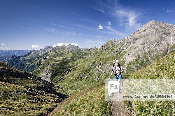Mountaineer climbing the Wurmaulspitze  Wilde Kreuzspitz behind  Vals Valley below  Pfunderer mountains  Eisacktal  South Tyrol  region of Trentino-Alto Adige  Alps  Italy  Europe