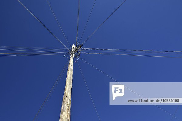 Electric cables and telephone lines attached to pylon  Uyuni Municipality  Bolivia  South America