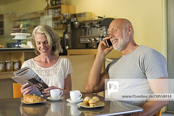 Older couple relaxing in cafe