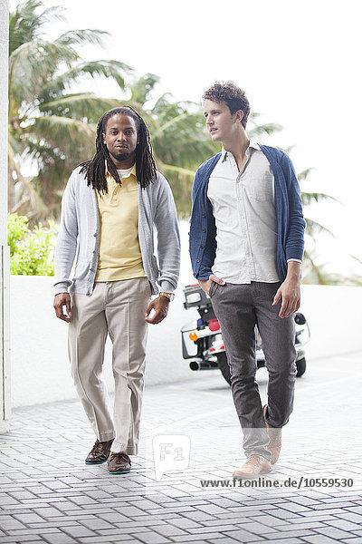 Businessmen walking on brick path