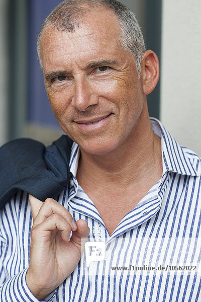 Close up of smiling Caucasian businessman