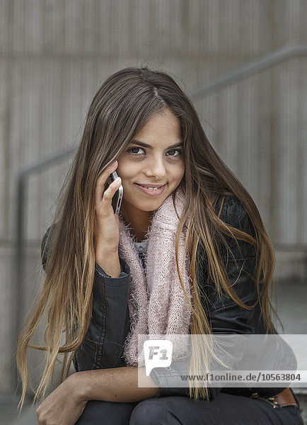 Caucasian woman talking on cell phone