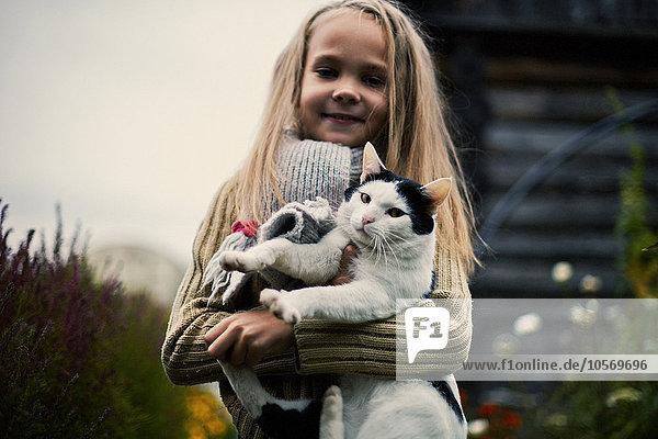 Caucasian girl holding cat