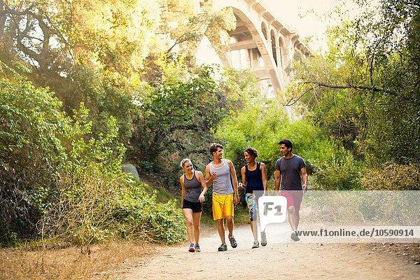 Joggers walking and chatting  Arroyo Seco Park  Pasadena  California  USA