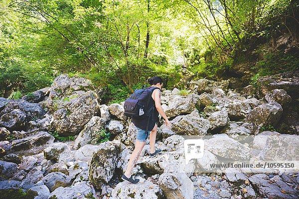 Tourist walking on rocks  Garda  Italy