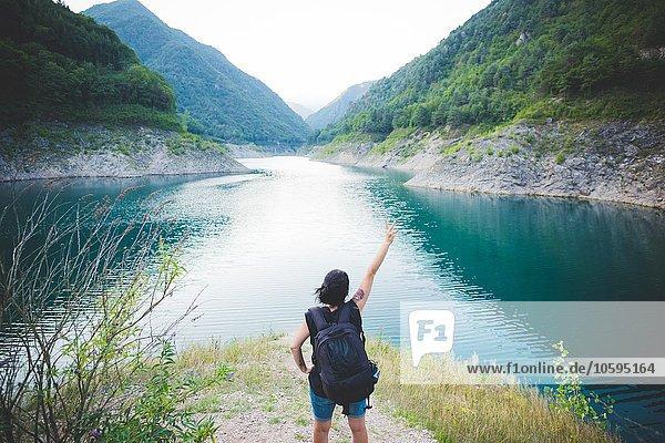 Tourist raising arm at Lake Garda  Italy