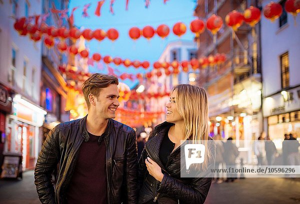Young couple strolling at night  Chinatown  London  England  UK