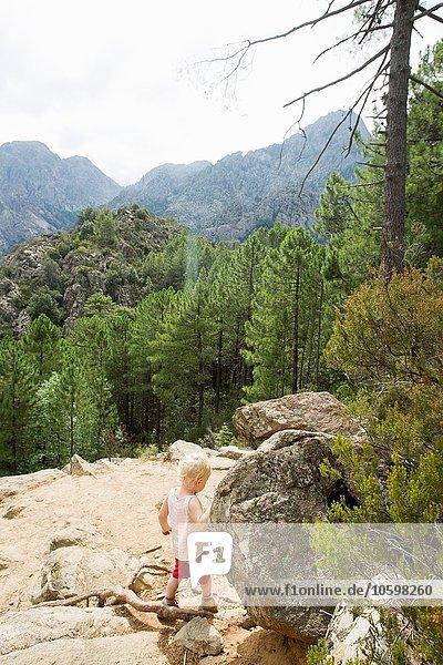 Female toddler exploring mountain rocks  Calvi  Corsica  France
