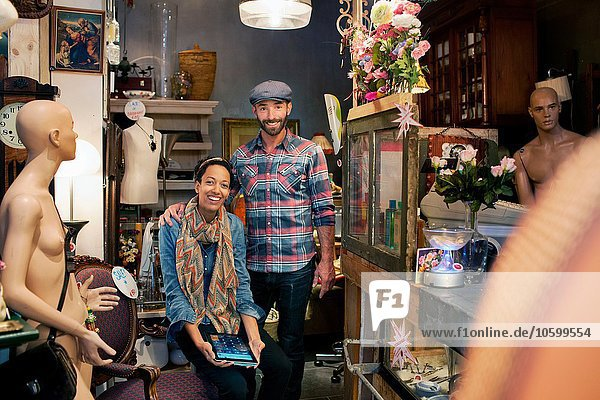 Portrait of male and female colleagues in vintage shop