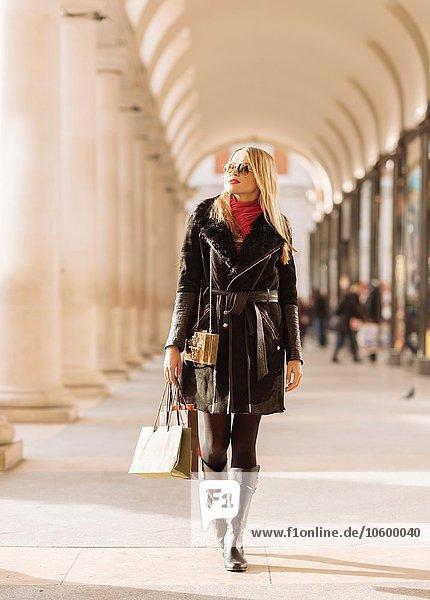 Stylish young woman carrying shopping bags  Covent Garden  London  UK