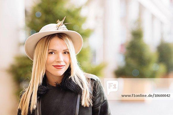 Portrait of stylish young woman wearing felt hat  Covent Garden  London  UK