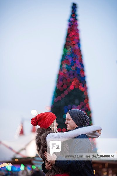 Romantic young couple hugging at xmas festival in Hyde Park  London  UK